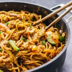 These spicy peanut noodles are perfect: thin noodles covered in a thick peanut butter sauce and accompanied by tender strips of shredded chicken.