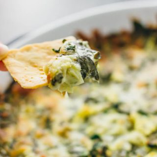 This is the best hot artichoke spinach dip that I've ever had -- it has artichoke hearts, fresh spinach, mozzarella cheese, and garlic, baked together in the oven until golden brown.