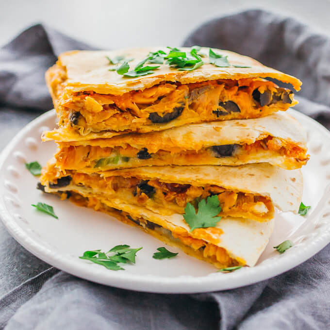 Calling all spicy food lovers: this quesadilla is filled with smoked salmon, black olives, jalapeños, pepper jack cheese, and a garlic-sriracha mayo sauce.