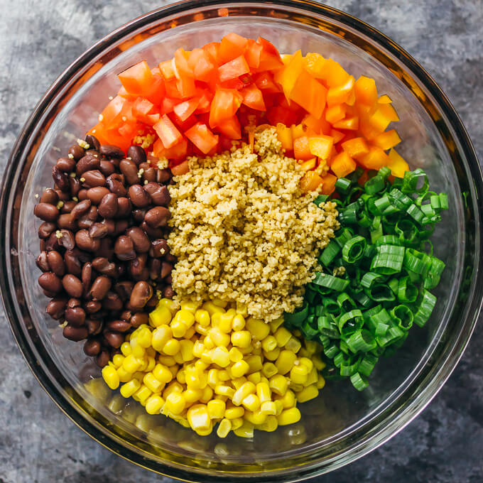 southwest couscous salad ingredients in glass bowl