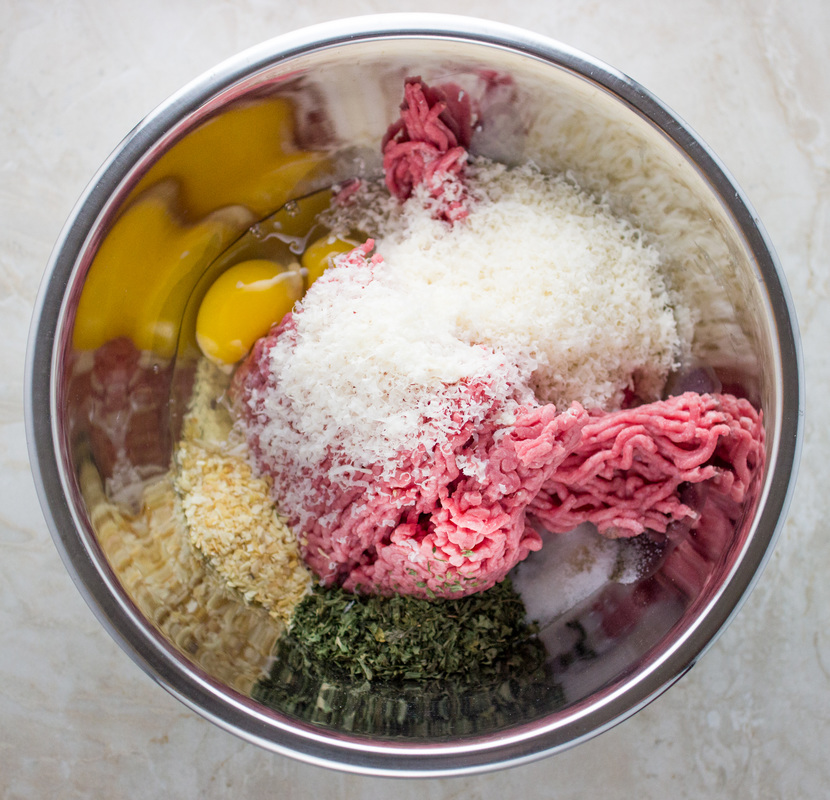 Ingredients for stovetop meatballs in a mixing bowl