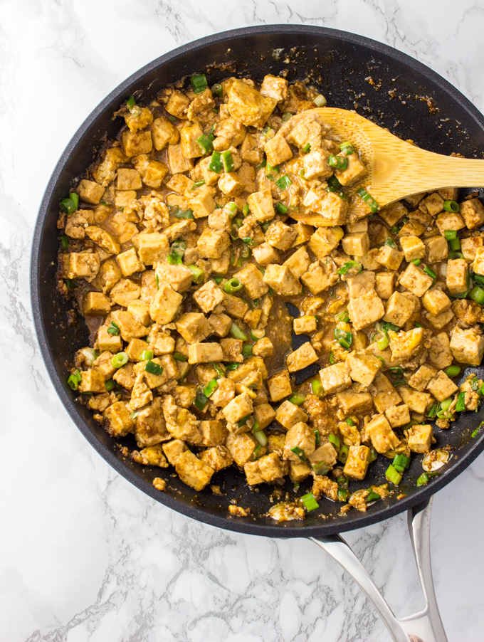 Delicious and healthy tofu cooked in a pan on stovetop