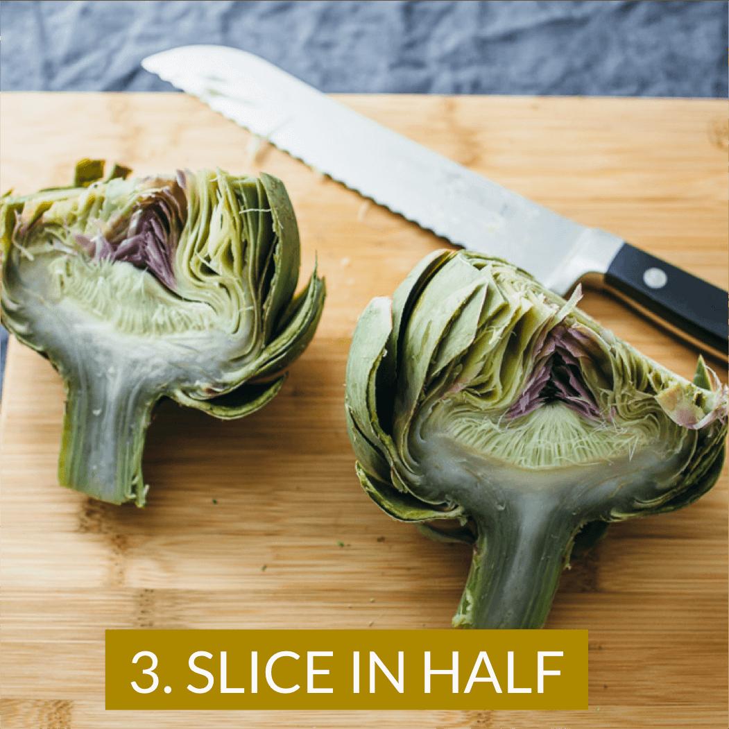 cooked artichoke sliced in half
