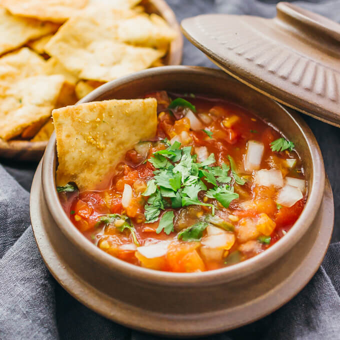 Mexican salsa doesn't get easier than this: you only need 5 ingredients to make this fresh, chunky, and spicy tomato salsa recipe.