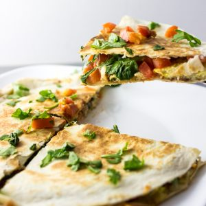 Garlicky breakfast quesadilla with shredded potatoes and arugula