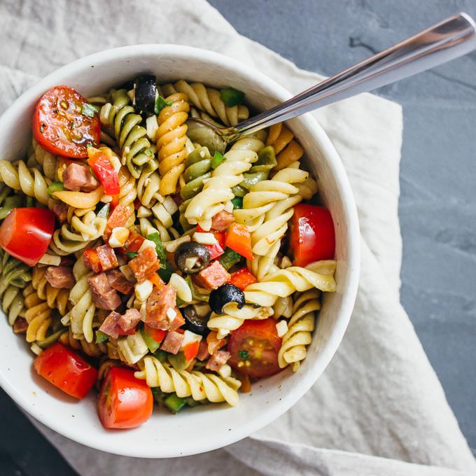 pasta salad served in white bowl