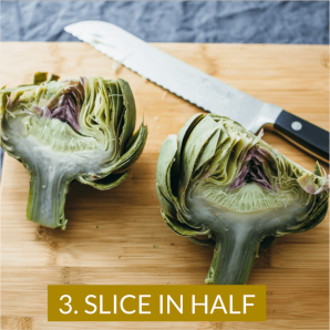 Photo shows how to eat artichokes by first slicing in half