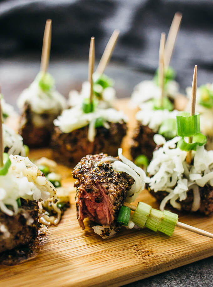 Peppered steak bites with cheese and scallions