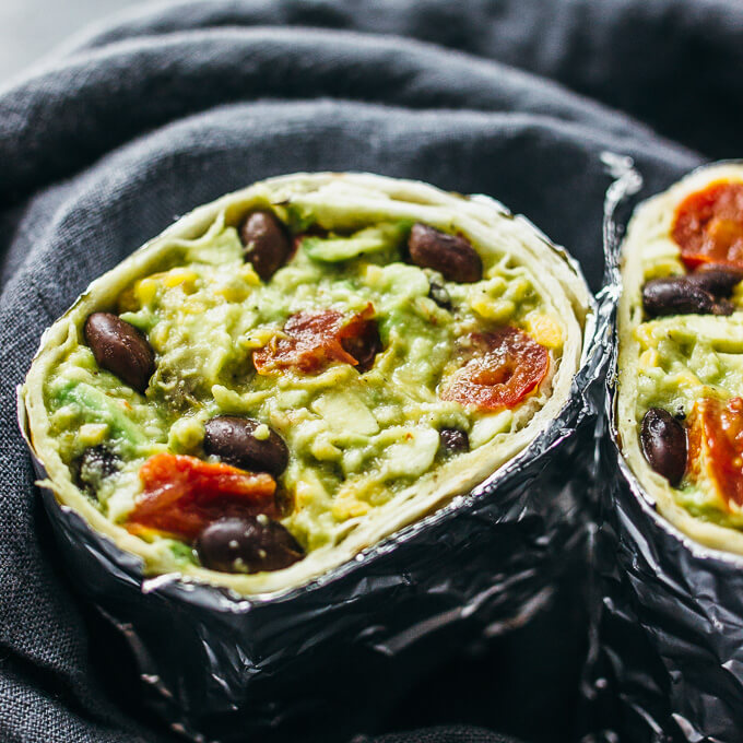 Guacamole burrito with balsamic roasted tomatoes and black beans ...