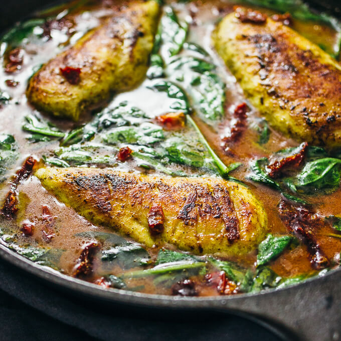Pan seared chicken with spinach in a coconut milk curry