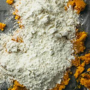 Dusting flour over mashed sweet potatoes