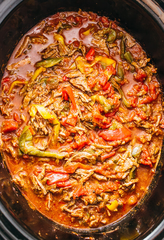 beef and bell pepper slices are cooked for hours in the slow cooker ...