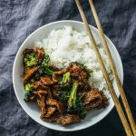 overhead view of beef and broccoli in white bowl