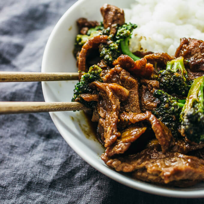 Using chopsticks to eat crazy good broccoli and beef