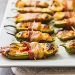 Bacon wrapped jalapeño peppers stuffed with cream cheese