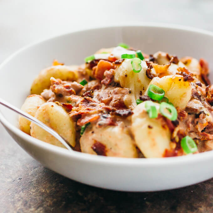 Baked gnocchi with bacon and sun-dried tomatoes