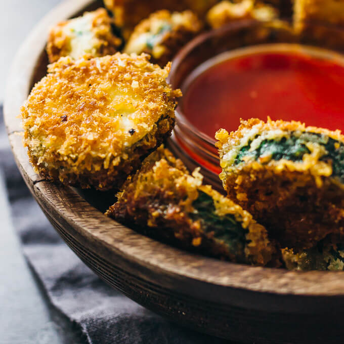 Crazy good fried zucchini slices with sweet sriracha sauce