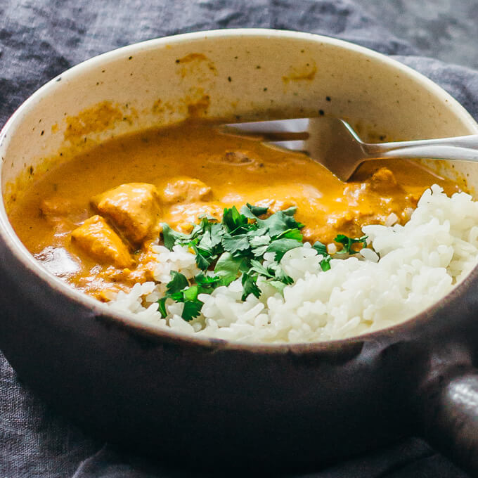 chicken tikka masala served with rice and cilantro