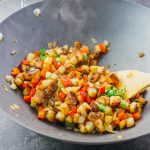 """These crispy skillet breakfast potatoes aka diner-style """"home fries"""" are addicting — they are pan-fried with onions and peppers, and tossed with lemon juice."""
