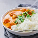This easy vegetarian potato curry has a delicious orange sauce similar to an Indian tikka masala sauce.