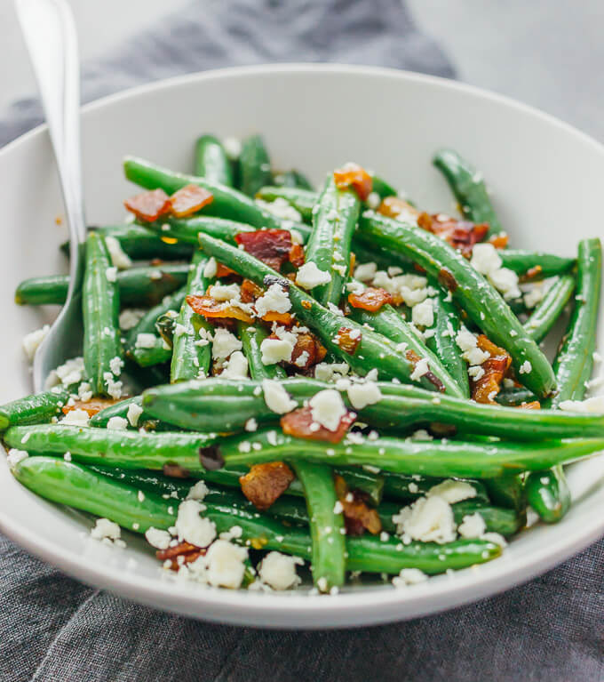 Garlic green beans sauteed with crispy diced bacon and crumbled feta cheese