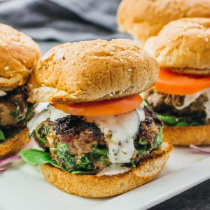 greek burgers served on a white platter