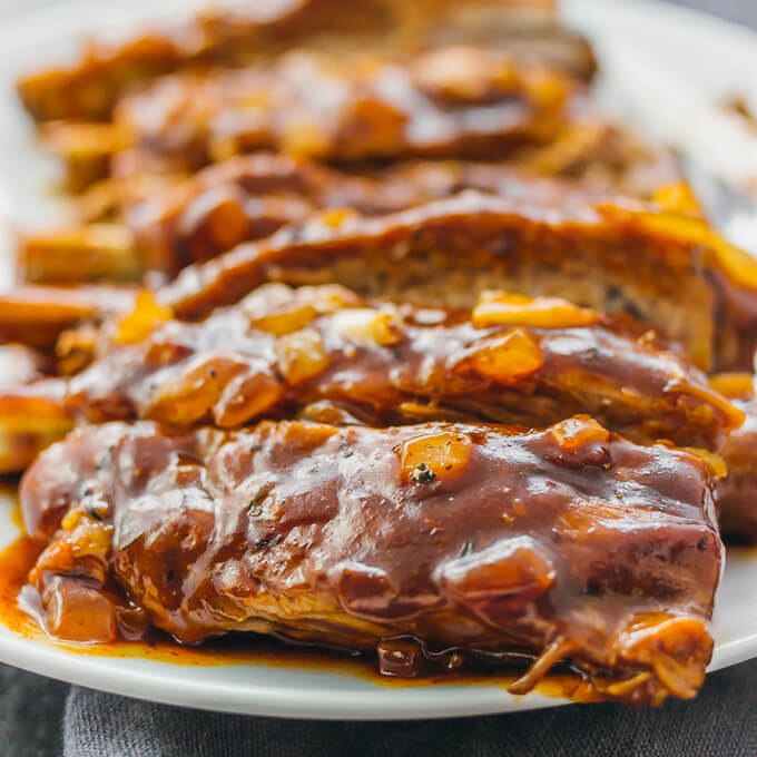 Pork ribs with barbecue sauce and onions are one of the most delicious and simple dishes you can make in the Instant Pot or slow cooker.
