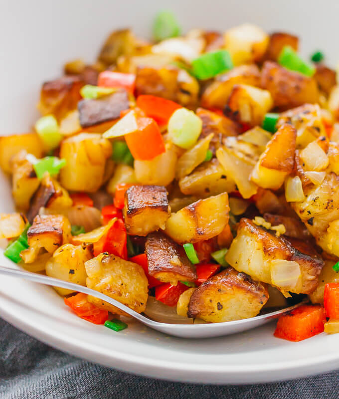 "These skillet breakfast potatoes or diner-style ""home fries"" are addicting -- crispy fried with onions and peppers, and tossed with lemon juice."