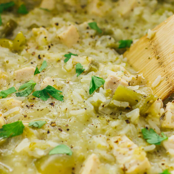 Close up view of salsa verde chicken and rice cooking in a large pot