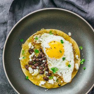 Huevos rancheros with salsa verde and black beans