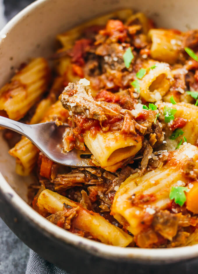 Using a fork to eat slow cooker beef ragu rigatoni