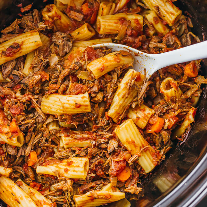Here's a recipe that really makes the slow cooker shine: deliciously tender shredded beef ragu sauce paired with rigatoni pasta.