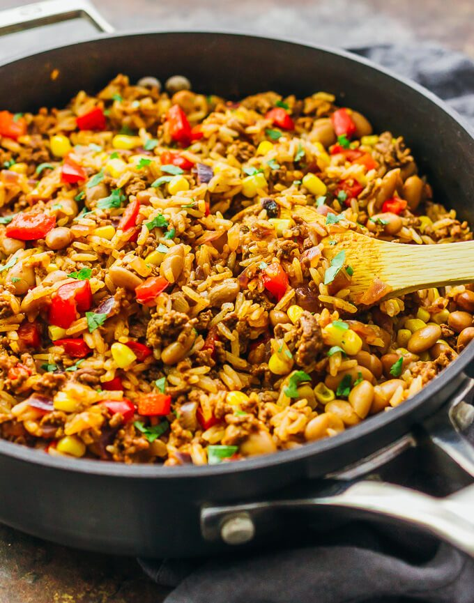 This tasty Southwest skillet has ground beef, rice, peppers, onions, pinto beans, corn, and a dash of cayenne -- all cooked together in one pan.