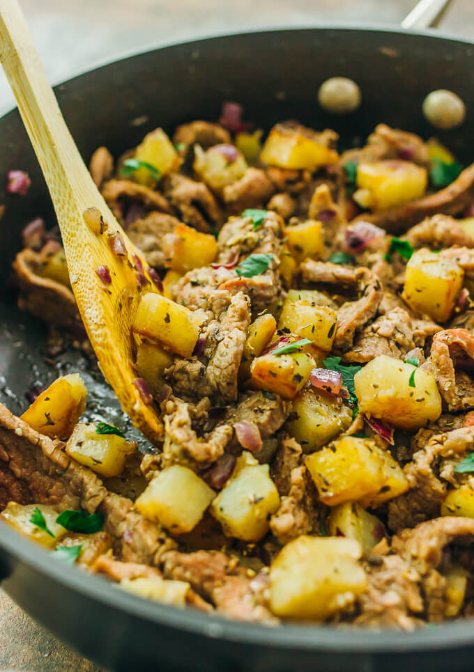 This skillet meal is an easy dinner with thinly sliced steak, cubed potatoes, and onions.