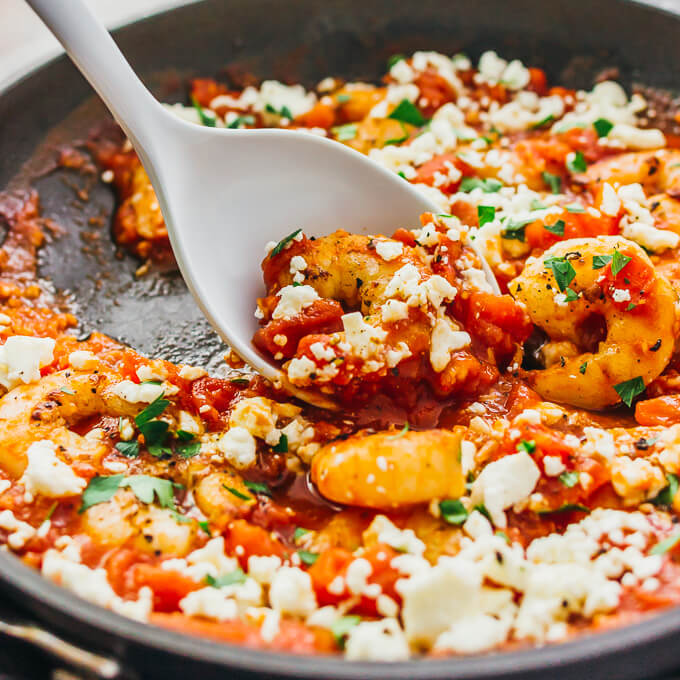 Pan seared shrimp with butter is one of my favorite ways of cooking shrimp, and it's sauteed with diced tomatoes, crumbled feta cheese, and minced garlic to form a tasty skillet dinner.