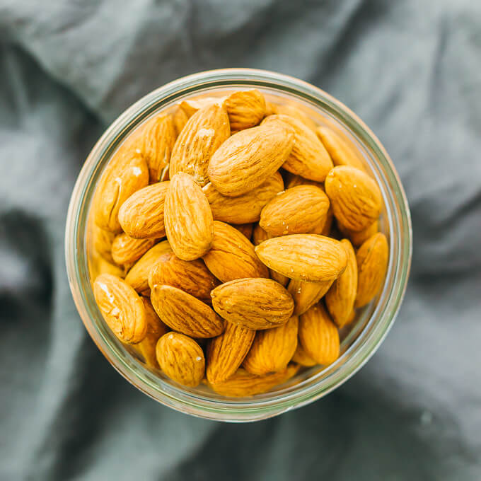 These savory spiced almonds have a spicy smoky garlic flavor, and are easily cooked in just 5 minutes on a pan. It's an easy vegan recipe that makes for a healthy and flavorful snack.