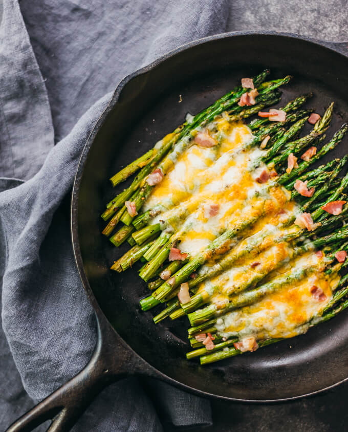 Easy roasted asparagus recipe shown in overshot shot of cast iron pan