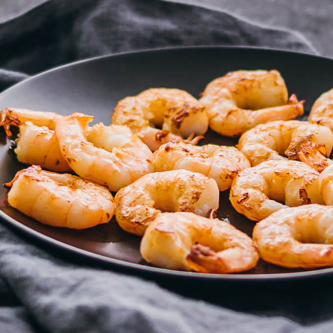 pan seared shrimp on black plate