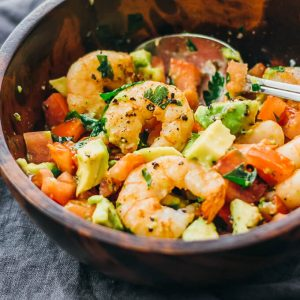 shrimp avocado salad in wooden bowl