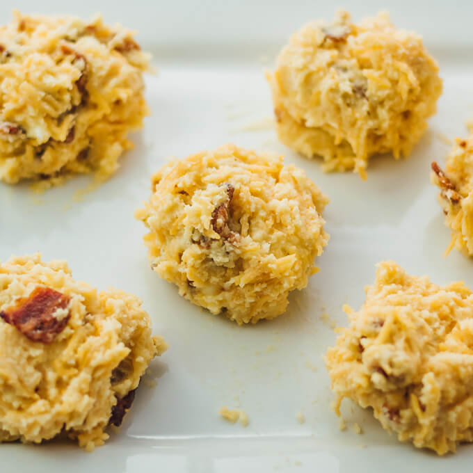 Biscuits can be delicious and healthy -- like these easy homemade biscuits made with almond flour, cheddar cheese, and bacon. Keto + low carb.