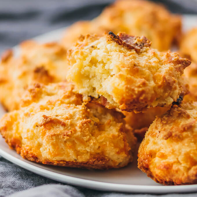 Low carb biscuits on a white plate and made using almond flour and cheese