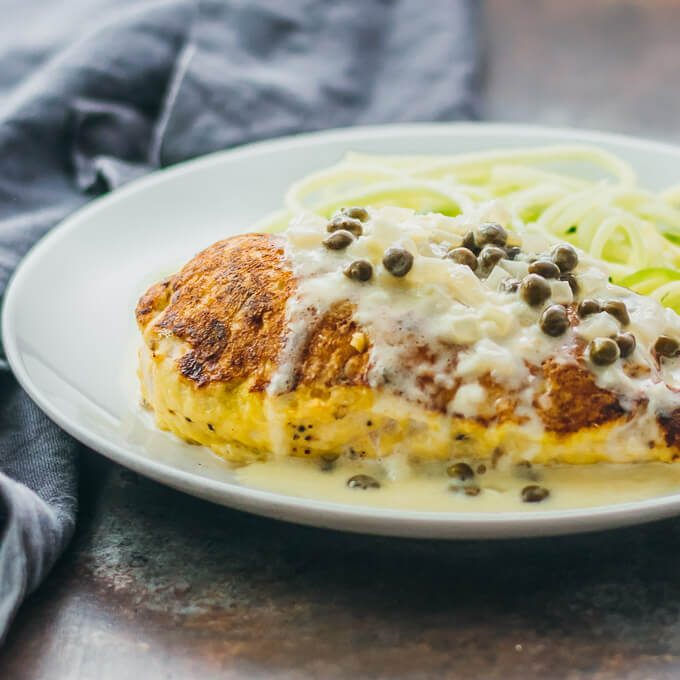These healthy chicken breasts are pan-seared and then roasted until tender and juicy. They pair fantastically well with a creamy lemon caper sauce.