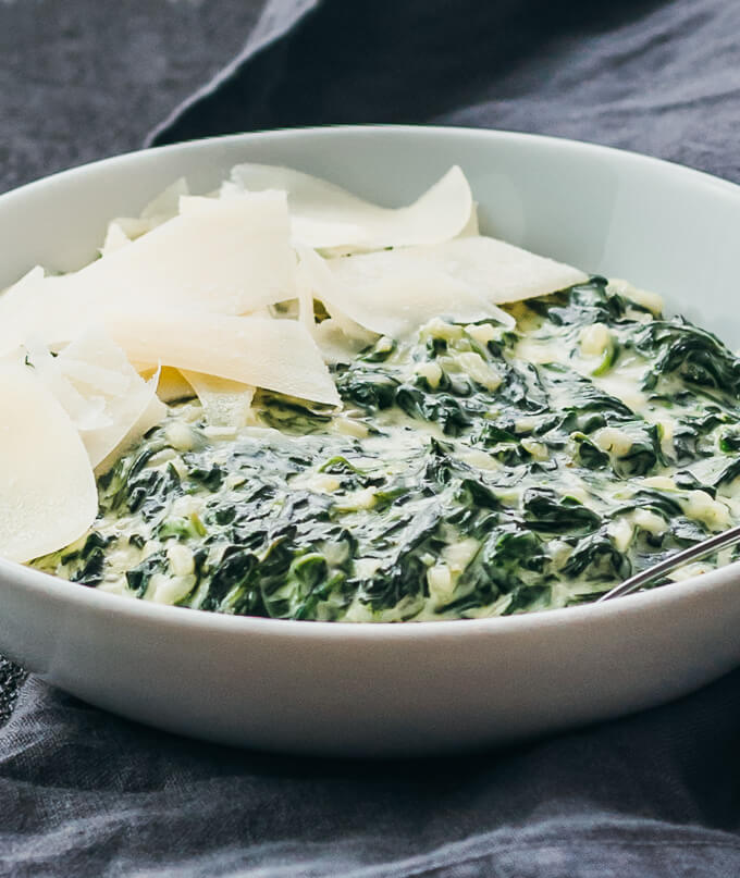 Close up view of a quick stovetop creamed spinach recipe served in a bowl