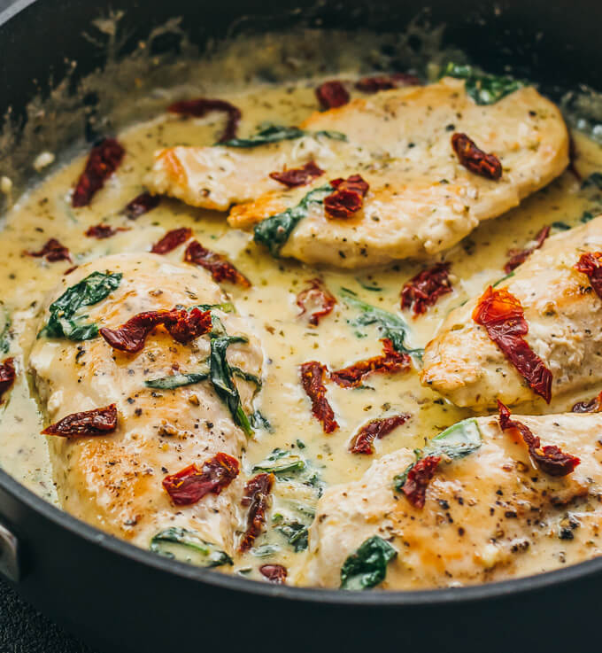 close up view of creamy tuscan chicken