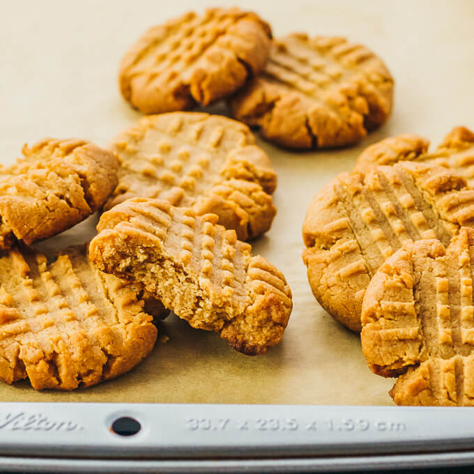 Baked keto peanut butter cookies with coconut flour on parchment paper