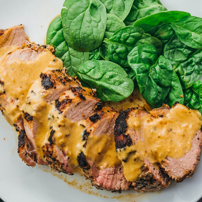 Overhead view of low carb & keto roasted pork tenderloin with mustard sauce