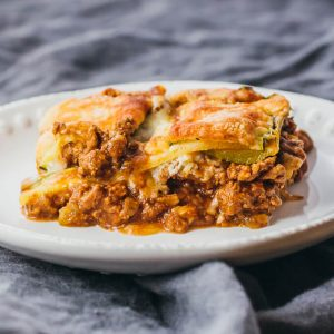 single serving of zucchini lasagna on white plate