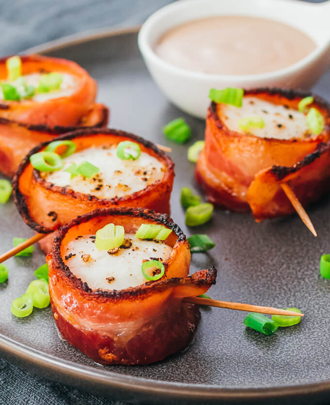 Low carb bacon wrapped scallops served on a plate with balsamic mayo