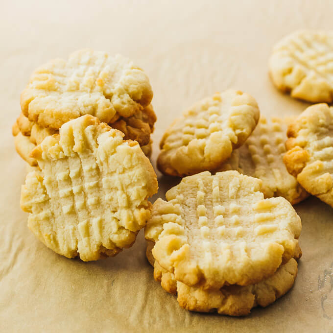 stacks of butter cookies on parchment paper