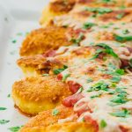 Easy chicken parmesan tenders fried on a pan and baked until crispy with tomato sauce and mozzarella cheese